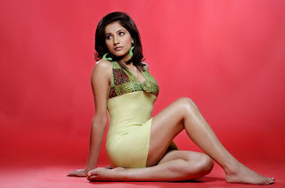A Indian model sits on the floor barefoot