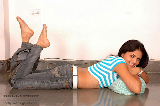 Tamil Actress Sunayana bare foot and legs in air as she strikes a pose for photo shoot