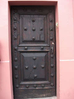 Beautiful wooden door with rivets in downtown Cuernavaca