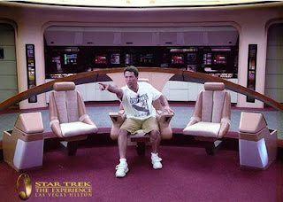 My husband posed for a picture in the Captains chair of the Star Trek Enterprise