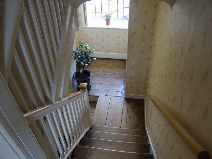 Looking down the stairs from outside Jane's bedroom at Chawton.