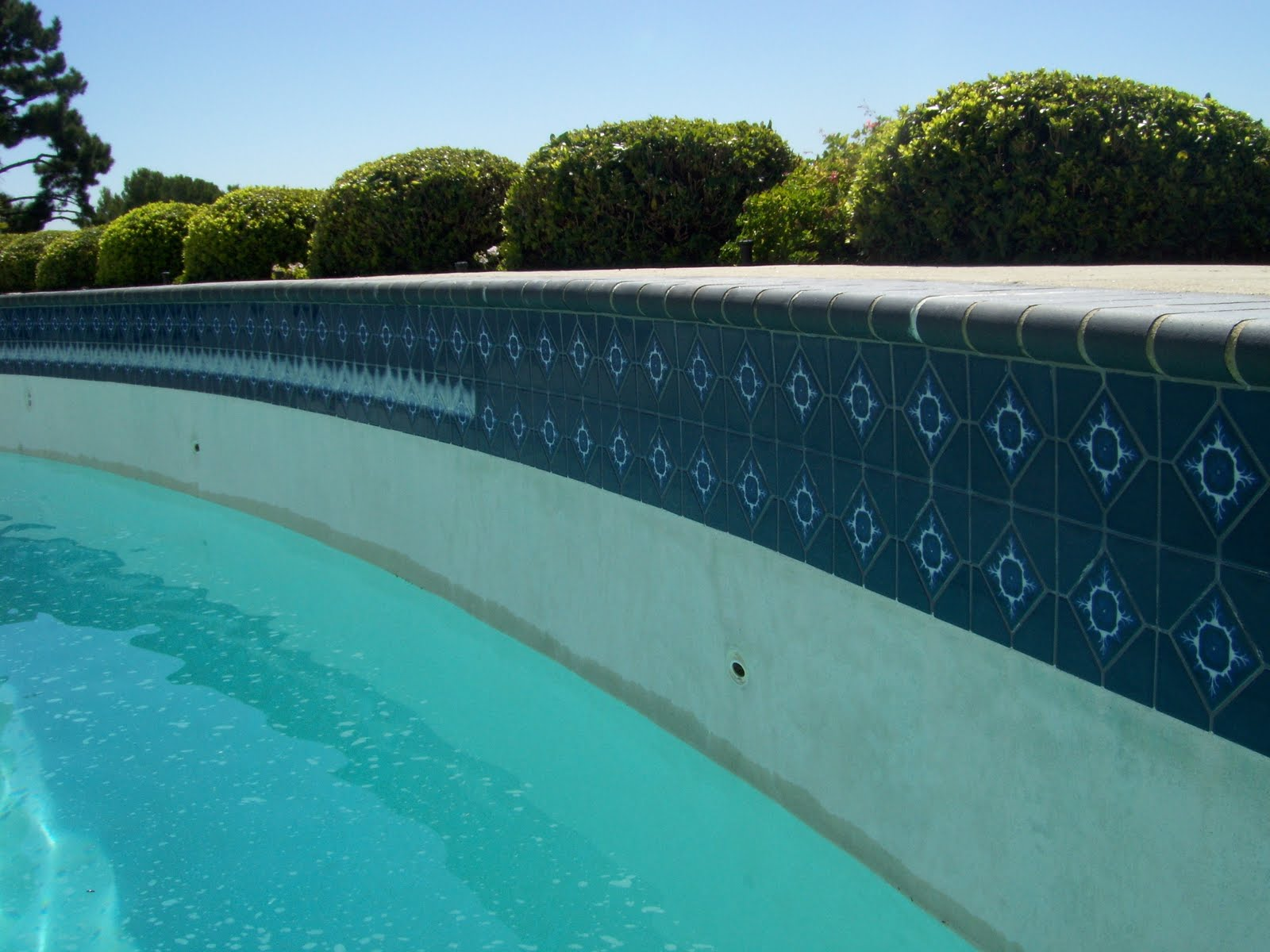Pool tile cleaning pro 877 835 8763 orange county los for Pressure clean pools