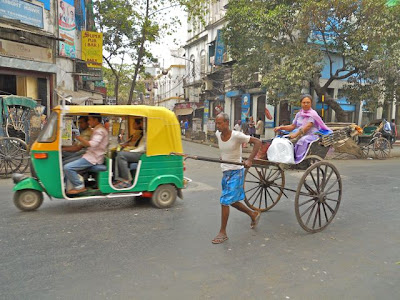 http://2.bp.blogspot.com/_F_C6Rx-h1-Q/S6hhSiE1XOI/AAAAAAAAANY/akCaiA_GQoU/s400/pull+rickshaw.jpg