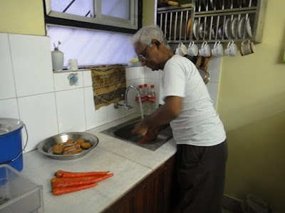Father helping in washing vegetables