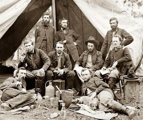 Custer with friends, Peninsula, Va., 1862. Custer has another dog in this photo