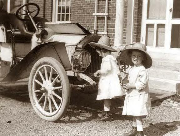 Twin girls with 1911 Buick Speedster