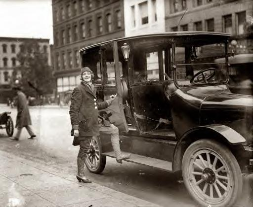 Woman taxi driver. 1919