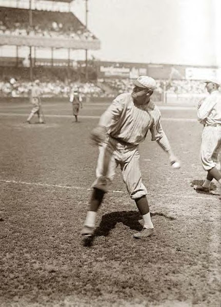 Babe Ruth throwing to baseman. Undated