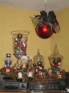 this is the dsiplay on top of my entertainment center it may be against the rule book to decorate the top of your electronics but my home is very small so - Entertainment Center Christmas Decorating Ideas