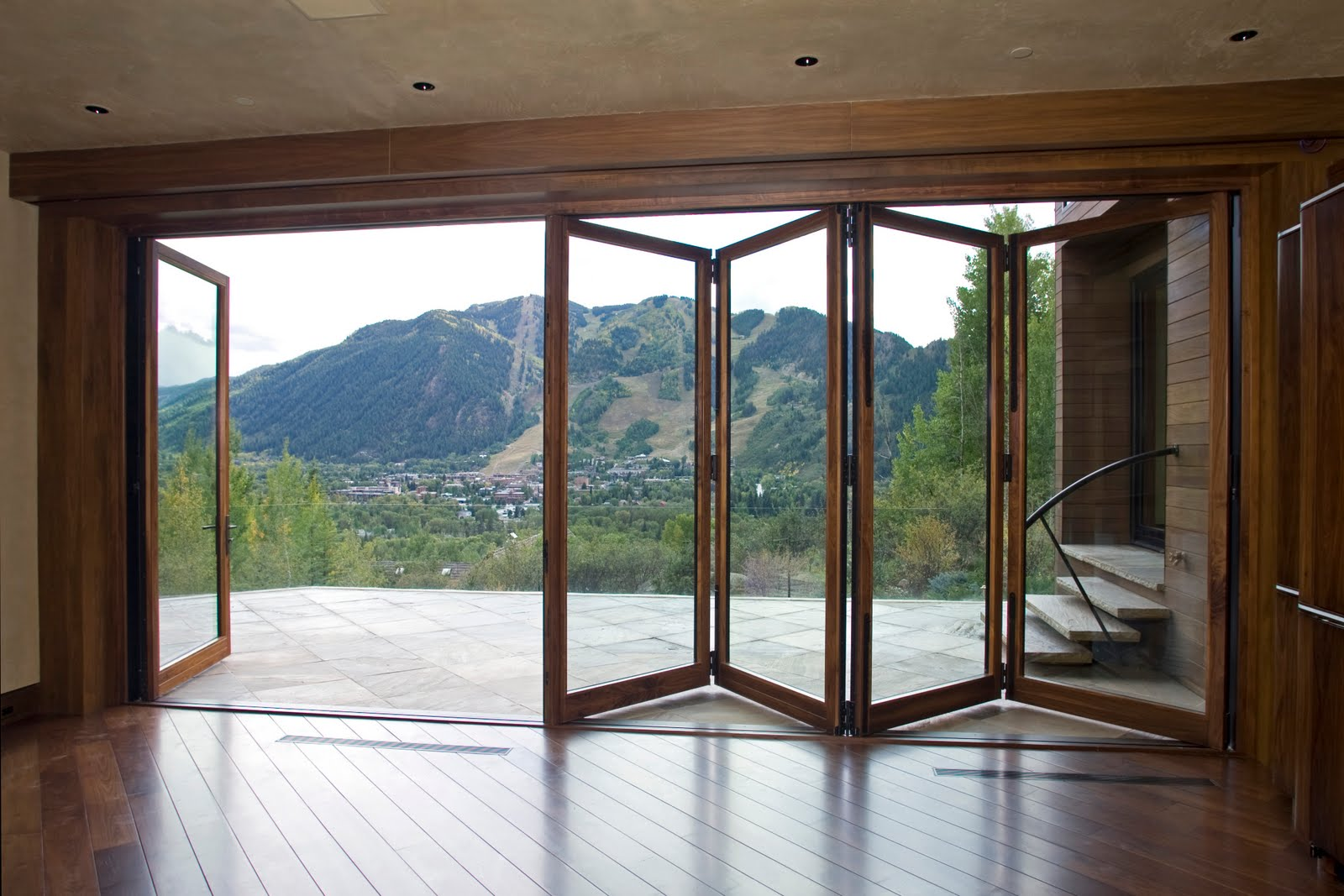 Grabill windows and doors product highlight folding doors for Outside door with window that opens