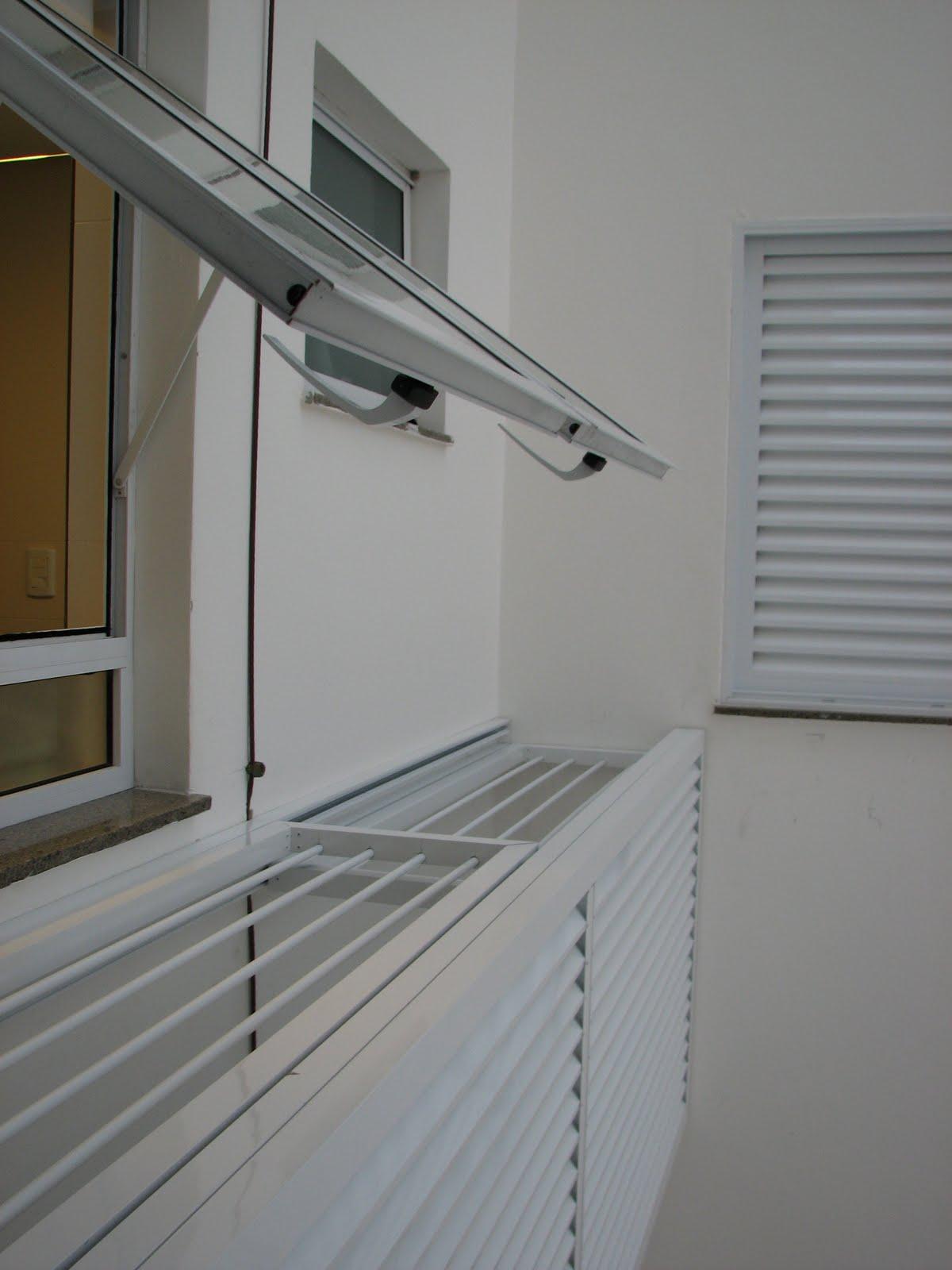 charles crippa speck arquitetura: varal e lavanderia #5D4B30 1200 1600