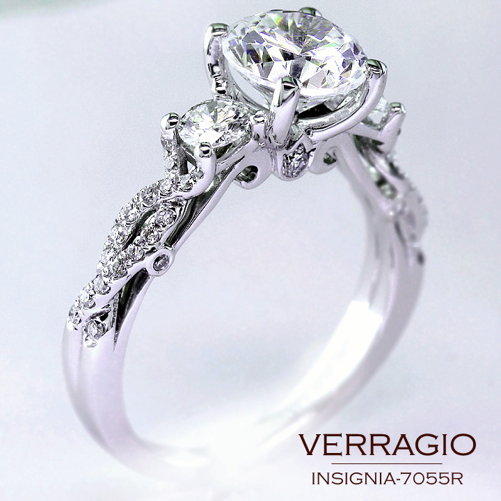 Classical three diamond engagement ring design with the stylish twisted band
