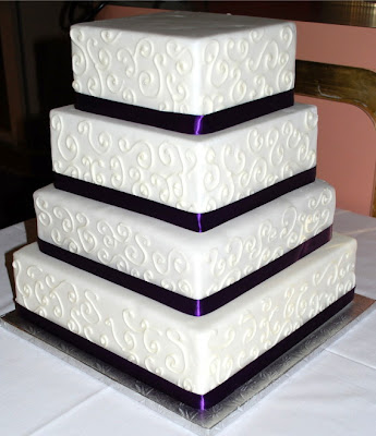 I love black and white wedding cakes. Black and white is dramatic colors.