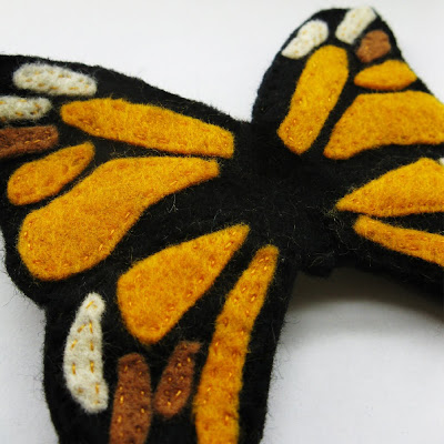 large yellow monarch butterfly brooch made from felt