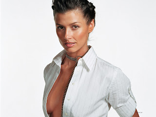 BRIDGET MOYNAHAN MODELING IN WHITE DRESS