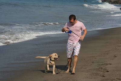 Cooper and Jason frolicking on Sycamore beach on his first visit to the Pacific Ocean