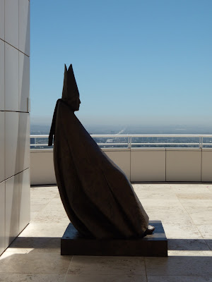 Seated Cardinal sculpture in silhouette at The Getty