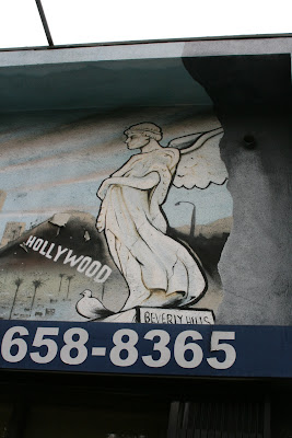 Sign with angel statue