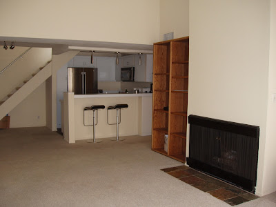Condo kitchen and fireplace