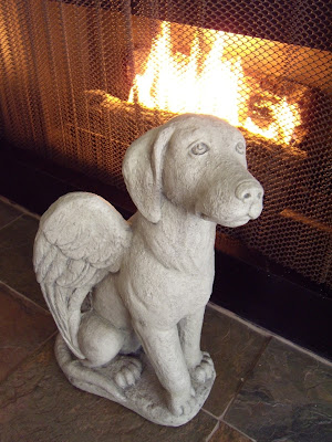 Angelic dog statue