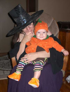 Halloween witch with pumpkin infant.