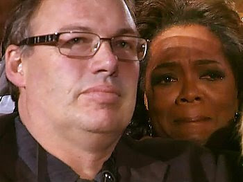 oprah weeps on stranger's shoulder