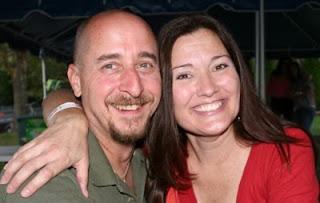 Engaged couple Roger Doran and Christine Ness pose