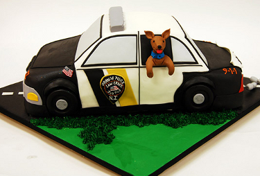 cop car with dog sticking his head out of the window cake