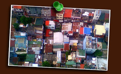 camphone picture of rooftops. taken from the penthouse suite of tivoli residences, pasig