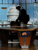Tim Russert's son, Luke, pauses over his father moderator's chair which he says he will keep forever
