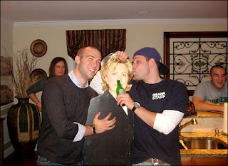Incoming Obama administration director of speechwriting Jon Favreau (L) and a friend pose with a cardboard cutout of incoming Secretary of State Hillary Rodham Clinton at a party. (Obtained by The Washington Post)