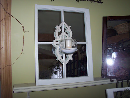 Candle sconce mirrored window