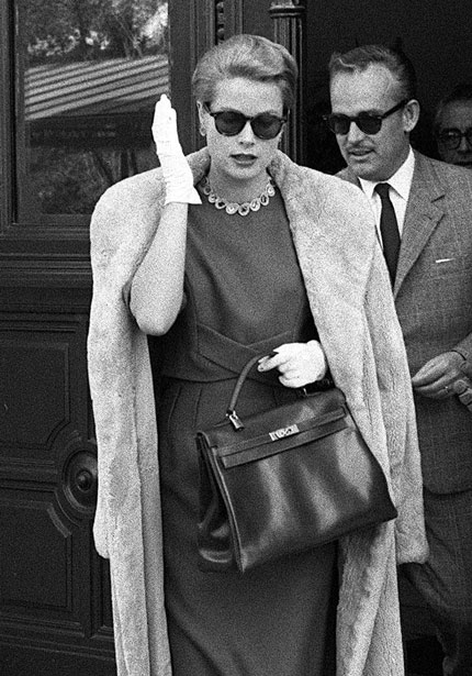 "Grace Kelly with her ""Kelly bag"" by Hermes"