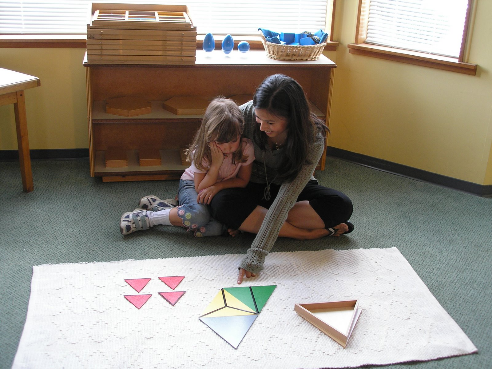 Gluing Redirecting Behavior NAMC Montessori Classroom Working Towards Normalization teacher and girl