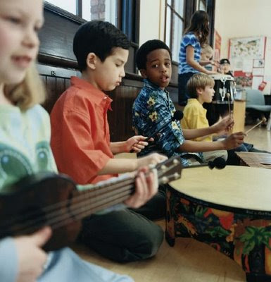 NAMC montessori music curriculum fun with composers program children playing music