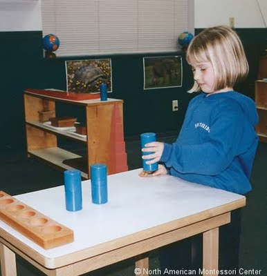 NAMC introduction to the montessori preschool classroom new montessori parents girl working with cylinders