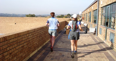 Lauren and Debbie follow the green signs leading us off the roof and back on to Wessels Road