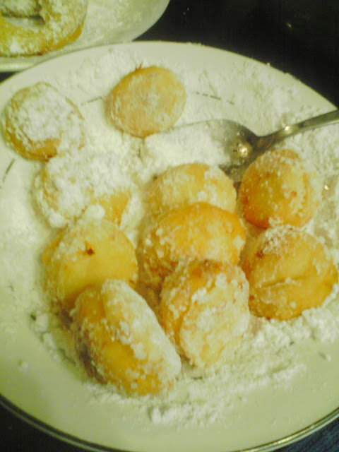 Powdered sugar donut hole recipe fried doughnuts is a fun sensory activity to do with kids/