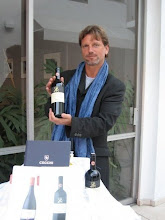Holding a bottle of the sponsors Cecchi Chianti Classico before the event in LA