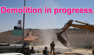 Israeli officers demolish the house
