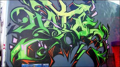 Tribal Graffiti On the City Street Wall