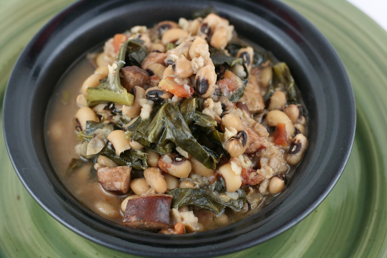 Hoppin' John is traditionally eaten on New Year's day to attract good...