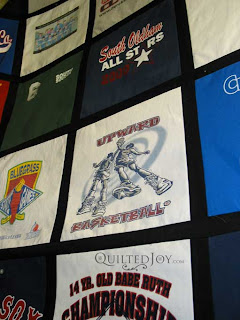 Sporty T-shirt quilt, quilted by Angela Huffman