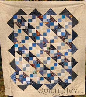 Scrappy quilt top waiting in the wings by Angela Huffman