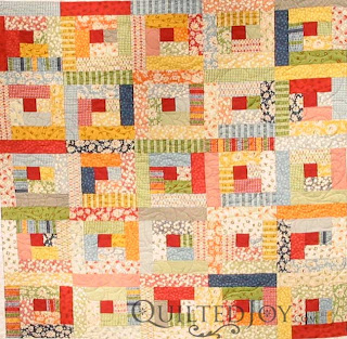 Dick and Jane Log Cabin quilt, quilted by Angela Huffman