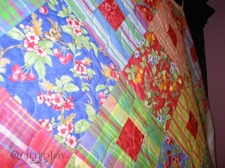 Margarita Sunrise Jelly Roll quilt, quilted by Angela Huffman