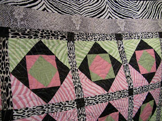 Shelly's Couture quilt, quilted by Angela Huffman