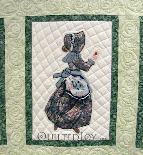 February block in a Hankie Lady Obsession Quilt with custom quilting by Angela Huffman - QuiltedJoy.com