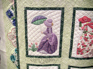 April block in a Hankie Lady Obsession Quilt with custom quilting by Angela Huffman - QuiltedJoy.com