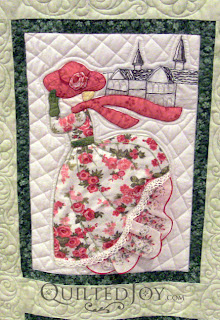 May block in a Hankie Lady Obsession Quilt with custom quilting by Angela Huffman - QuiltedJoy.com